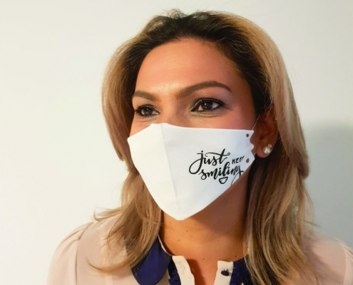 A lady wearing a custom printed face mask